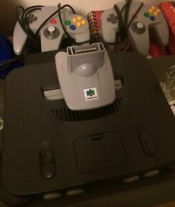 N64 with 2 controllers and 6 games.