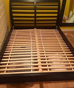 Queen size bed frame solid wood.  New condition