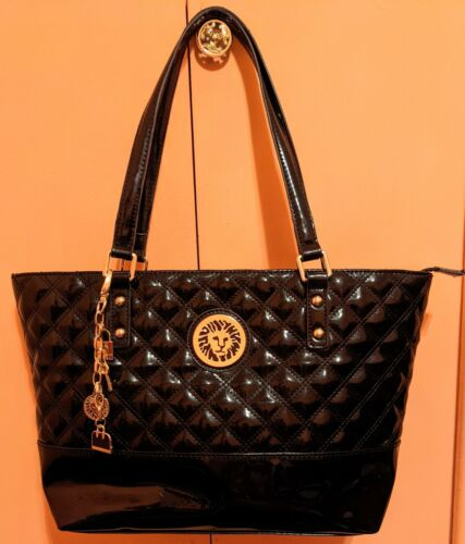 Anne Klein Black Faux Leather Handbag with Lion Logo and Cha