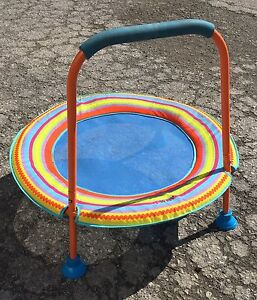 Children's trampoline with safety bar