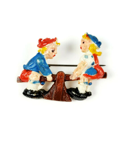 Vintage Dutch Boy and Girl on SeeSaw Celluloid Plastic Brooch Pin