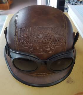 Vintage leather Harley Davidson motorcycle hard hat with goggles