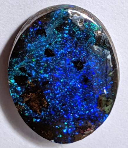 5.6ct Solid Black Boulder Opal BLUE PINFIRE Oval fromQLD Australia