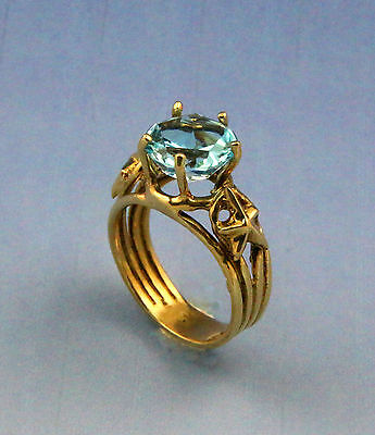 Four Band Gold Star Design    Lone Star Cut Blue Topaz 14K Ring