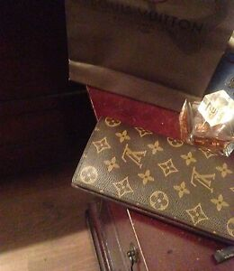 louis vuitton womens wallet real