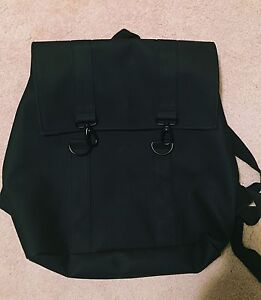 Large black leather backpack from Rains
