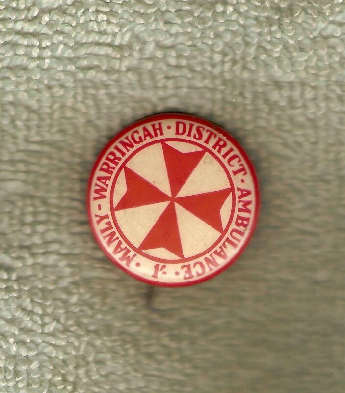 #D52.  MANLY WARRINGAH DISTRICT AMBULANCE  TIN BADGE
