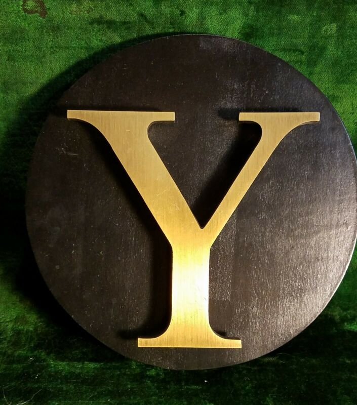 """Gold Letter """"Y"""" Raised And Attached To Black Wood Circle"""