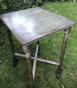 Vintage Cast steel Industrial Table with heavy duty wheel