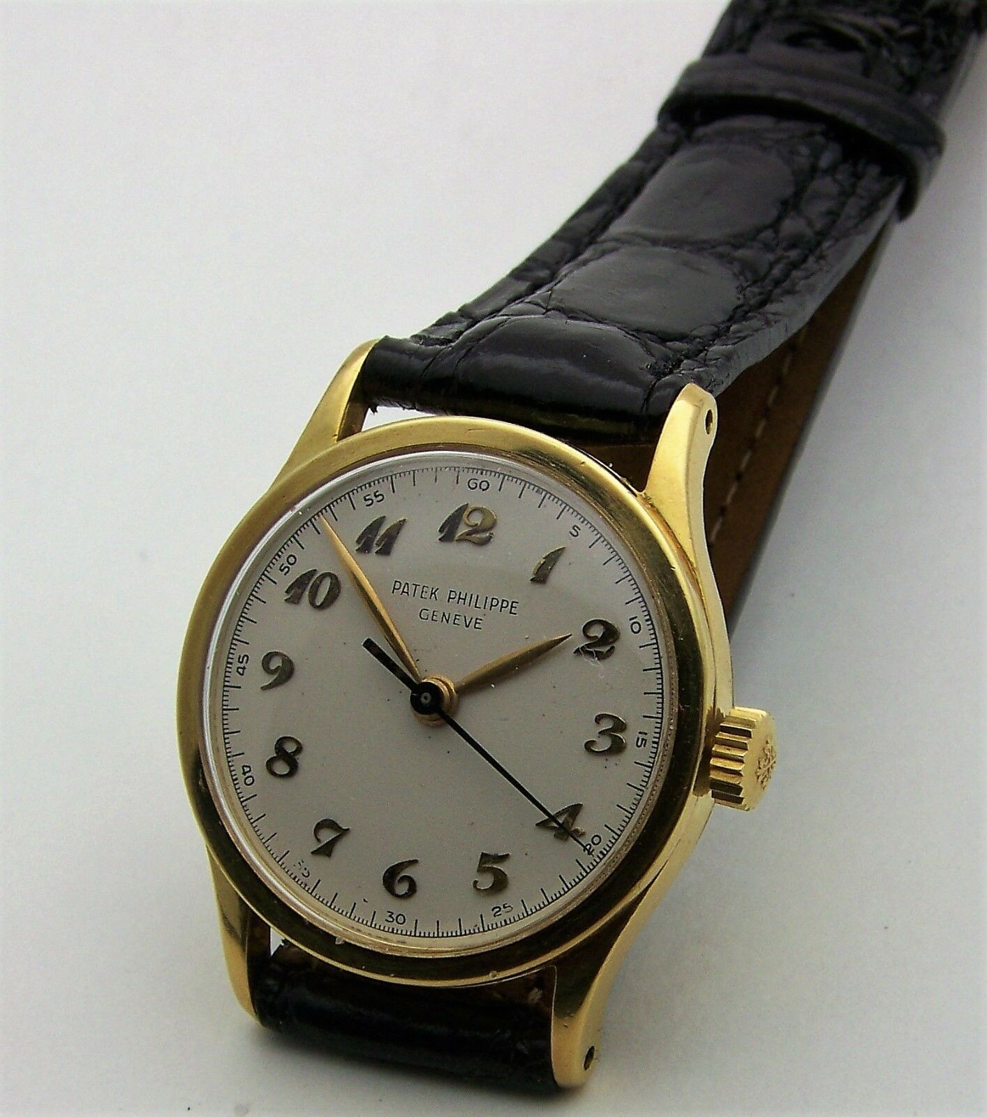 $6995.00 - Vintage 1940's 18K Yellow Gold Patek Philippe Mans Sweep Second Calatrava 2457