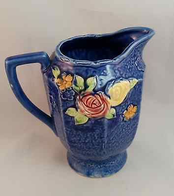 Vintage Blue Pitcher with Pink and Yellow Flowers.