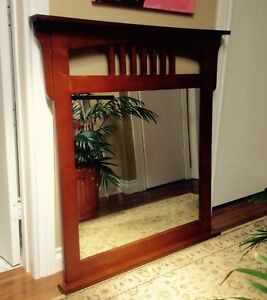 Wood-framed mirror 40x37""