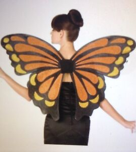 With sz medium strapless dress and brand new wings in pkg