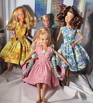 Beautiful Mattel Barbie Dolls Lot of 4 (includes vintage dresses)