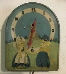 Dutch Boy and Girl Tin Litho Animated Windmill Wall Clock