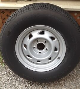 Michelin  XW4  tire and new gmc rim   ,  P235 70 R15  one only