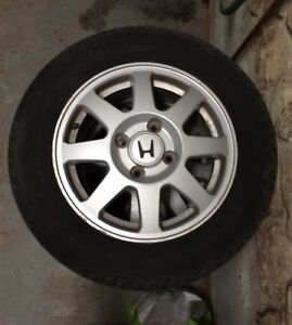 15 inch (4) winter tires with original honda mags