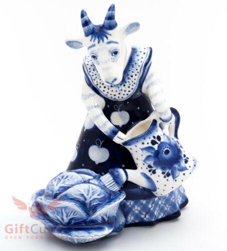 Gzhel porcelain figurine of Goat farmer watering cabbage