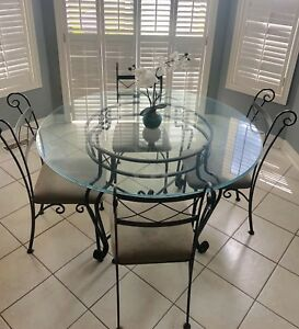 Tempered glass top with wrought iron chairs