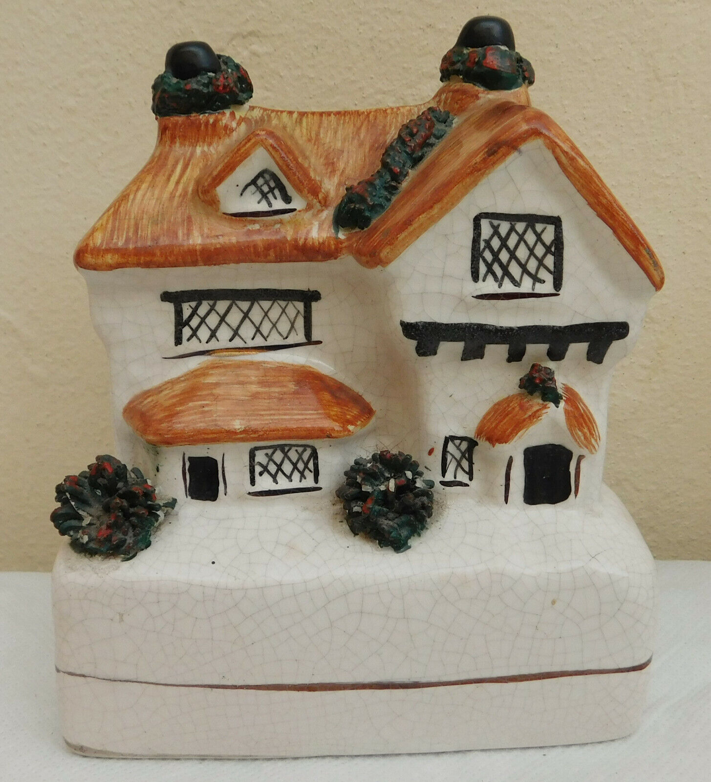 Ceramic cottage money box Staffordshire style pottery thatched house