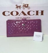 Coach Embossed Clutch