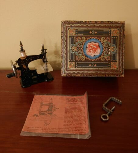 Ernst Plank Model 0 Toy Sewing Machine with Original Case, Instructions and Clam