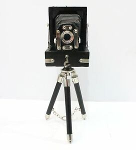 Antique Style Vintage Folding Camera With Black Wooden Tripod Home ...