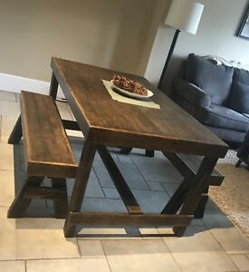 Handcrafted wood table with benches