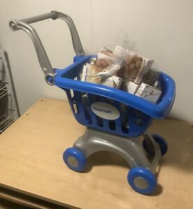 Push cart with grocery items