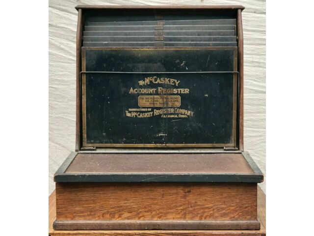 EARLY 20TH C. ANTIQUE OAK & TOLE MCCASKEY ACCOUNT REGISTER CA. 1910