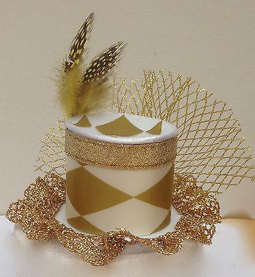 Gold Harlequin mini top hat fascinator