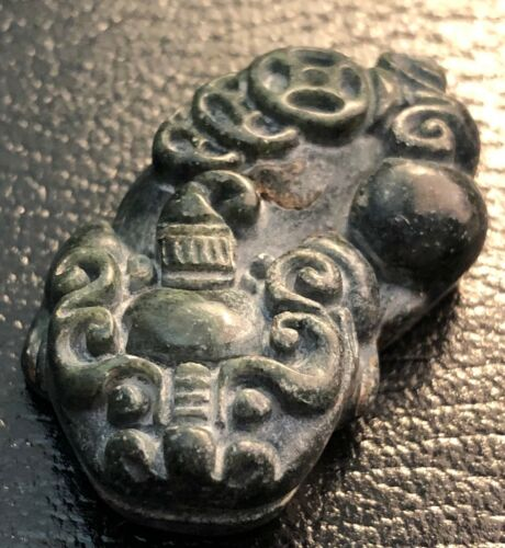 Antique Chinese finely carved green jade amulet with foo dog theme