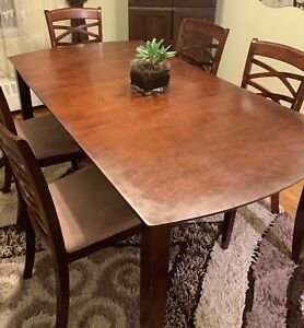 6 pieces dining set (5 chairs and an adjustable table)