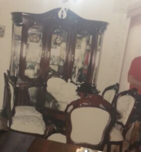 Cherry wood dining room table with 6 chairs and hutch