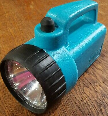 Vintage Rayovac Flashlight, plastic, turquoise, takes disc-style lithium cell ba