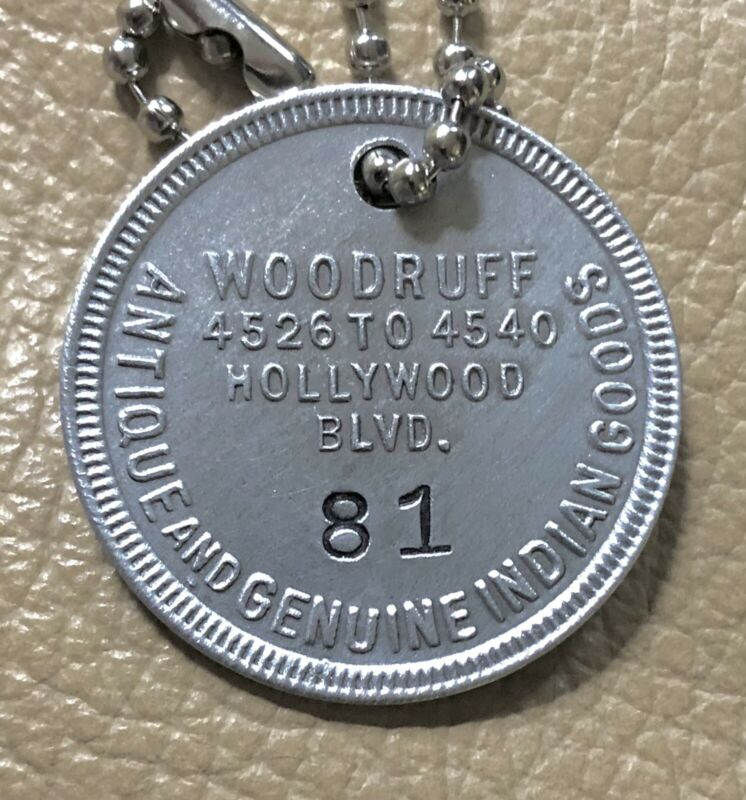 Vint Charge Coin Tag: WOODRUFF STORE; Hollywood CA; Antique & Indian Goods; #81