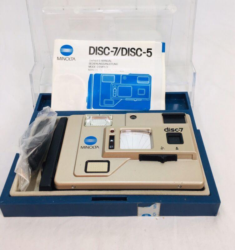 Vintage Minolta Disc-7 Camera with Manual. Excellent condition.
