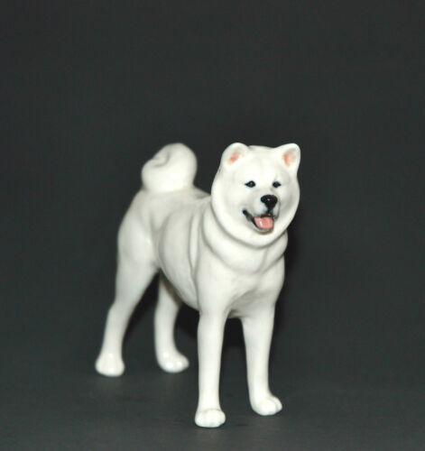 Statuette made of porcelain dog Akita Inu white