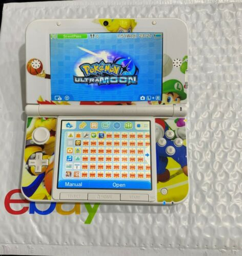 Nintendo 3DS XL - FULL 64gb TO PLAY PLEASE READ DETAILS WITH VINYL DECAL