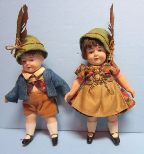 vintage celluloid German boy and girl dolls