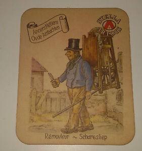Sottobicchiere-STELLA-ARTOIS-Ancien-Metiers-Oude-Ambachten-cm-9-9-x-8-Remouleur
