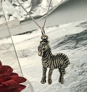 Silver coloured zebra pendant with real sterling silver chain