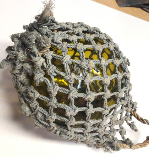 """Vintage Amber glass fishing float w rope net 21"""" circumference or 6"""""""