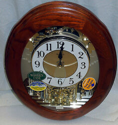 RHYTHM MUSICAL WALL CLOCK -THE JOYFUL NOSTALGIA IN OAK W/ 18 MELODIES 4MH852