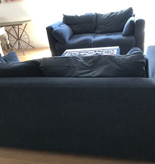 Large Lounge suite -one is pull out bed )coffee table and rug  $90