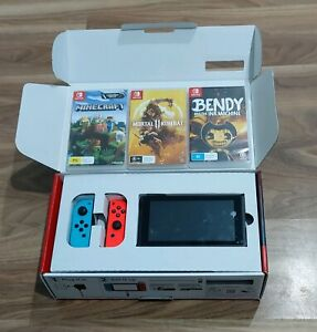 Nintendo switch with games, and micro SD card