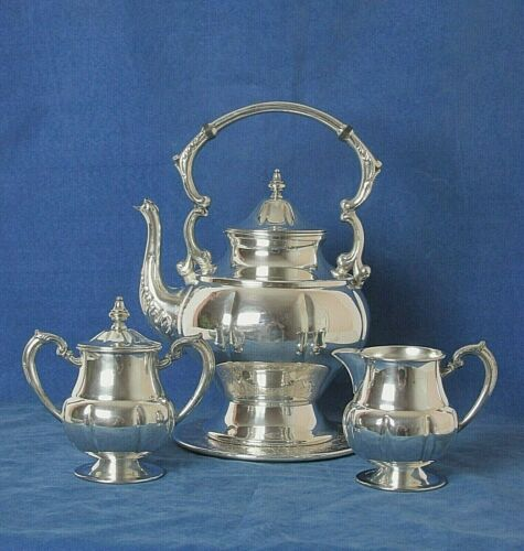 LEHMAN BROTHERS NY NY SILVER PLATED 4 PC TEA SET WITH KETTLE AND HOT PAD