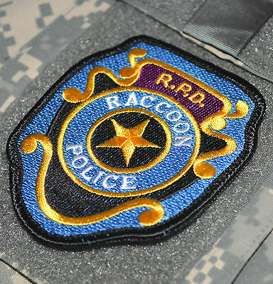 RESIDENT EVIL ZOMBIE OUTBREAK CIVIL SURVIVAL KIT RACCOON CITY POLICE INSIGNIA x1