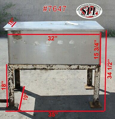 Bottle Can Dump Station Stainless Steel Used On Four Steel Legs Which Are Rusty