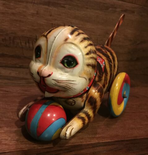 Vintage Cat holding a Ball Tin Litho Tail Wind Toy Made in Japan So cute!